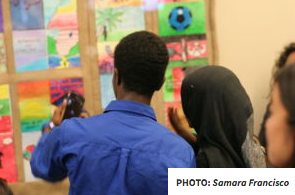 Samara Francisco's students at High Tech High take photos of their work, which illustrated stories of refugees.